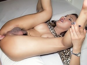 And's Ladyboy asshole puckers and gapes while covered in hot sperm. And lifts up her leopard print dress showing her naturally hairy Ladyboy cock